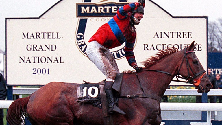 Richard Guest celebrates after winning the 2001 Grand National on Red Marauder