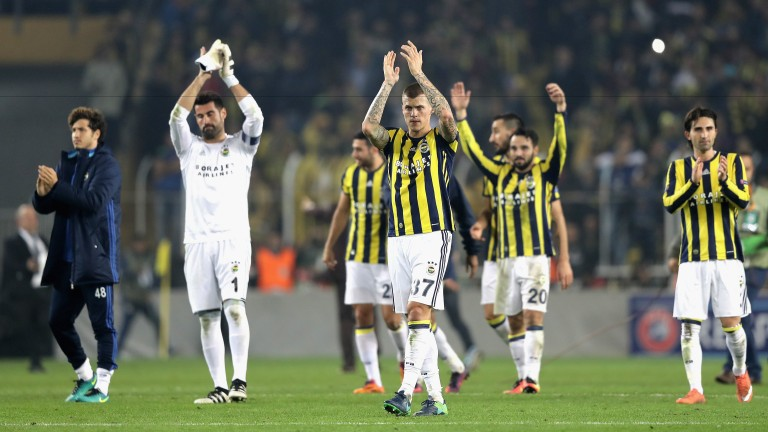 Martin Skrtel of Fenerbahce and the rest of his team applaud supporters