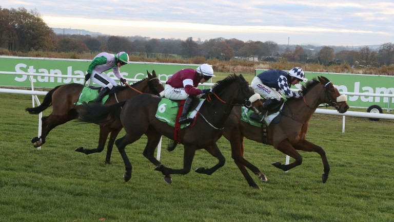 Irving (right) just holds on from Apple's Jade in the Fighting Fifth at Newcastle