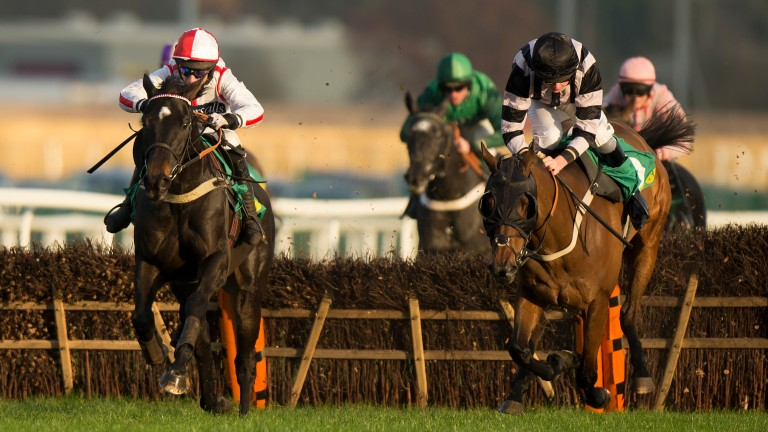 Who Dares Wins (left) ahead of third-placed Makethedifference in the Gerry Feilden Hurdle