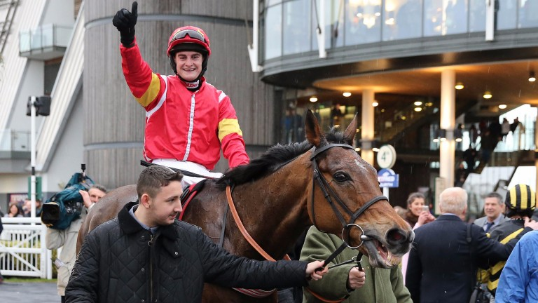 Henry Brooke celebrates victory in the Betfred Becher Chase aboard Highland Lodge 12 months ago