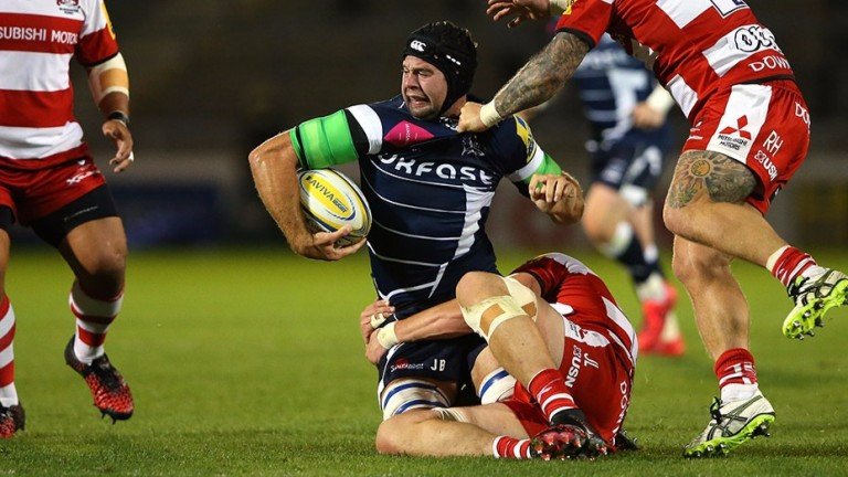 Josh Beaumont of Sale is tackled against Gloucester
