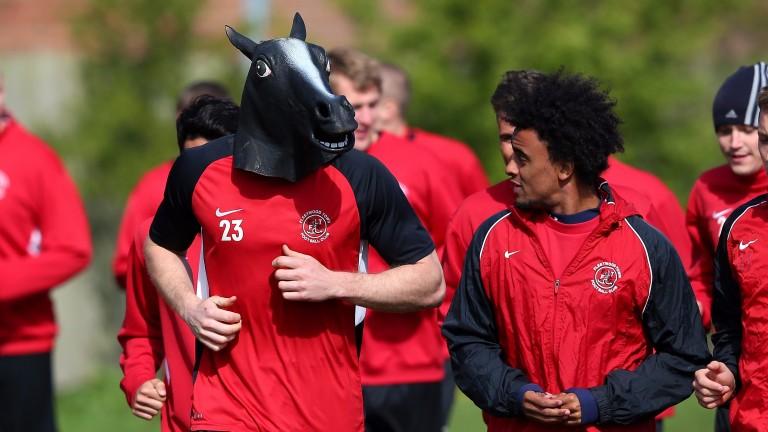 Fleetwood players lark around in training