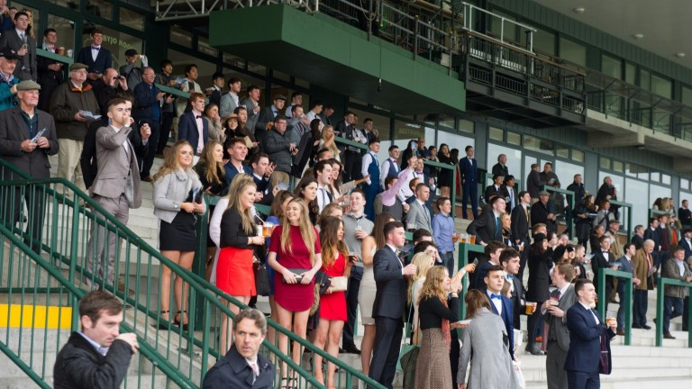 Racegoers enjoy the action on student day