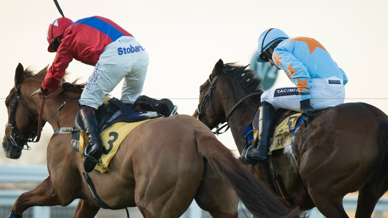 Un De Sceaux and Ruby Walsh (right) battle for supremacy with Sire De Grugy and Jamie Moore in the Tingle Creek