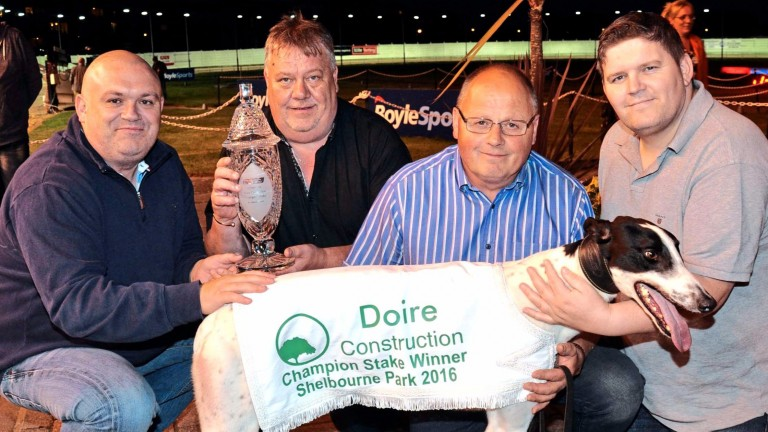 Clares Rocket with joint-owners Alan Murphy (left) and Joe Cahill (right) and  trainer Graham Holland (second right)