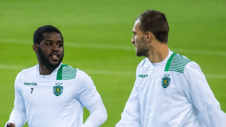 Sportings Bas Dost (R) and Joel Campbell