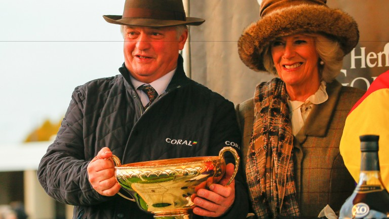Colin Tizzard holds the Hennessy Gold Cup alongside the Duchess of Cornwall after Native River's victory