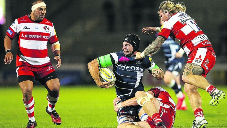 Josh Beaumont of Sale Sharks is tackled by Richard Hibbard and Joe Latta of Gloucester
