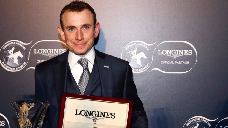 Ryan Moore poses with his trophy after being crowned Longines World's Best Jockey