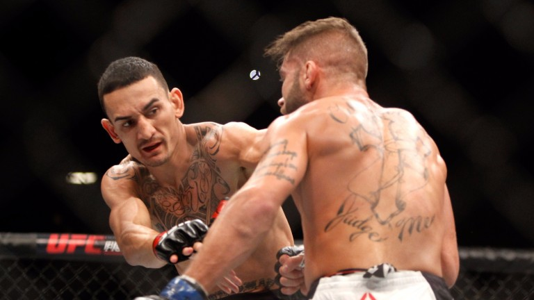 Max Holloway (left) gets to grips with Jeremy Stephens at UFC 194