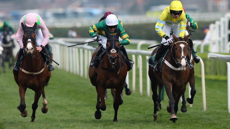 Theinval (yellow, right) in winning form at Aintree