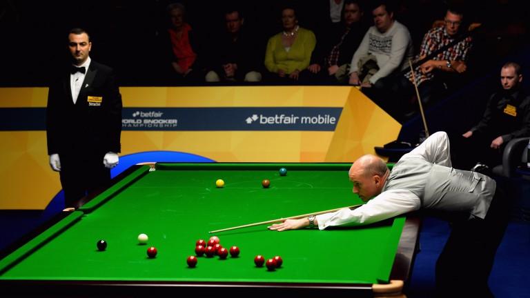 Peter Ebdon gets among the balls