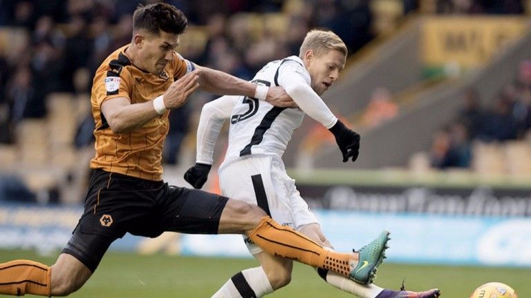 Wolves defender Danny Batth (left) at full stretch