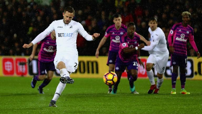 Gylfi Sigurdsson slots home Swansea's opener against Sunderland