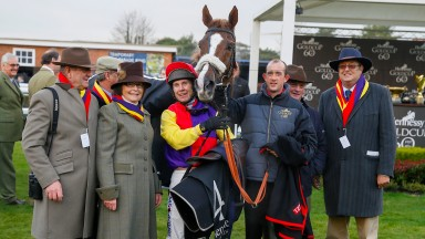 Husband-and-wife team Garth and Anne Broom (far left) of Brocade Racing in the winner's enclosure with Native River and jockey Richard Johnson after their Hennessy triumph