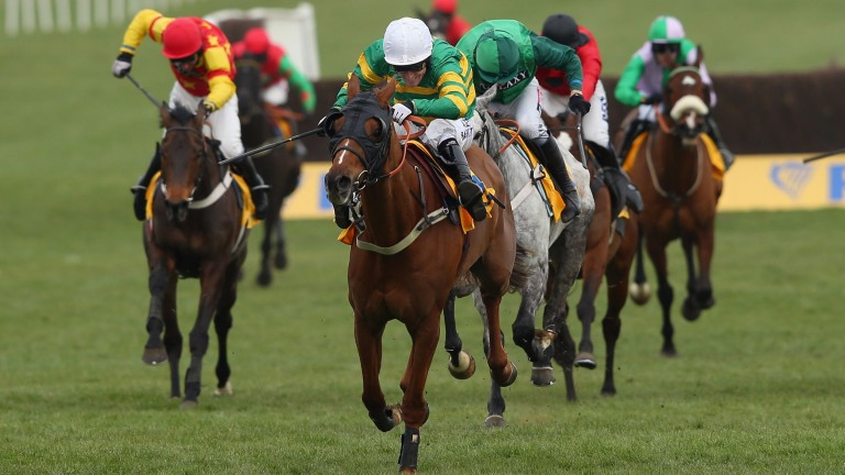 Eduard (left, red cap) finishes fourth to Uxizandre in the 2015 Ryanair Chase at the Cheltenham Festival