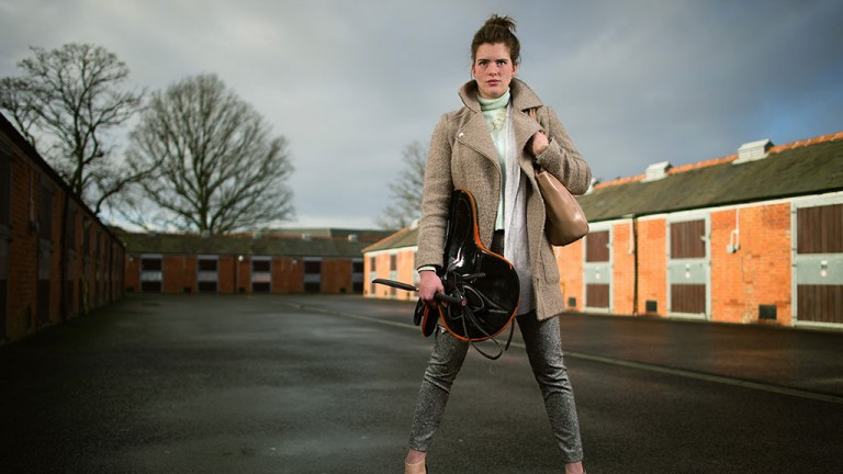 Standing tall: Lizzie Kelly strikes a pose in the stable yard at Newbury