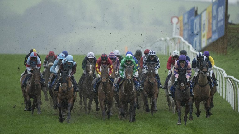 Runners and riders battle through the flying mud around Chepstow's undulations in one of the sport's toughest tests of endurance, the Coral Welsh Grand National, rescheduled from December