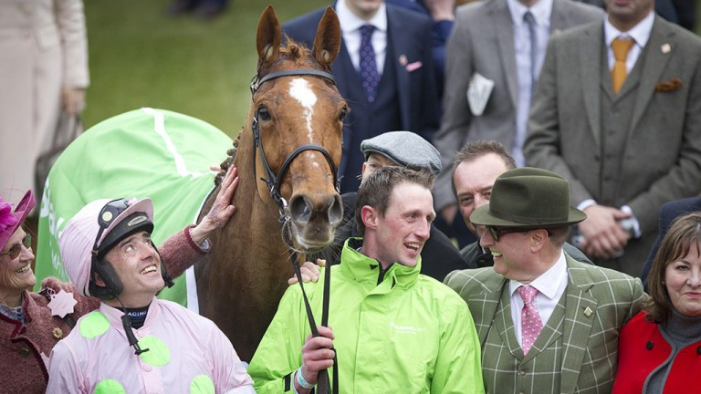 You beauty: Ruby Walsh looks up admiringly at Annie Power following the mare's brilliant performance in the Champion Hurdle