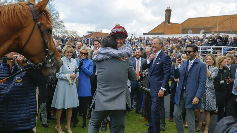 Full of emotion: Frankie Dettori and Hugo Palmer share a hug after their 2,000 Guineas triumph at Newmarket