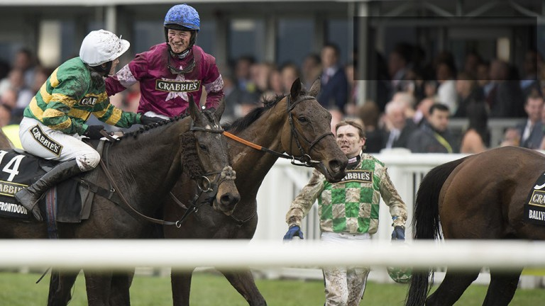 Top of the world: David Mullins is congratulated after guiding Rule The World to Grand National glory