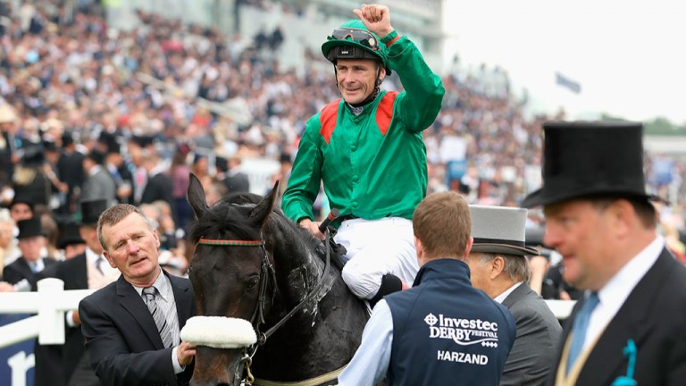 Man of the hour: a delighted Pat Smullen celebrates his Investec Derby triumph at Epsom