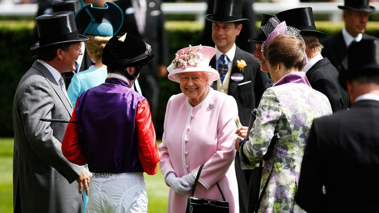 Royal smile: the Queen arrives in the parade ring before the Jersey Stakes