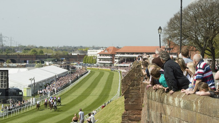 Jostling for position: spectators line Chester's city walls during the 1m2½f handicap won by Dark Red