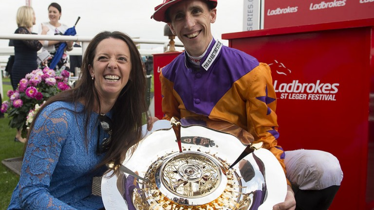 All smiles: Laura Mongan and George Baker celebrate their memorable St Leger success at Doncaster