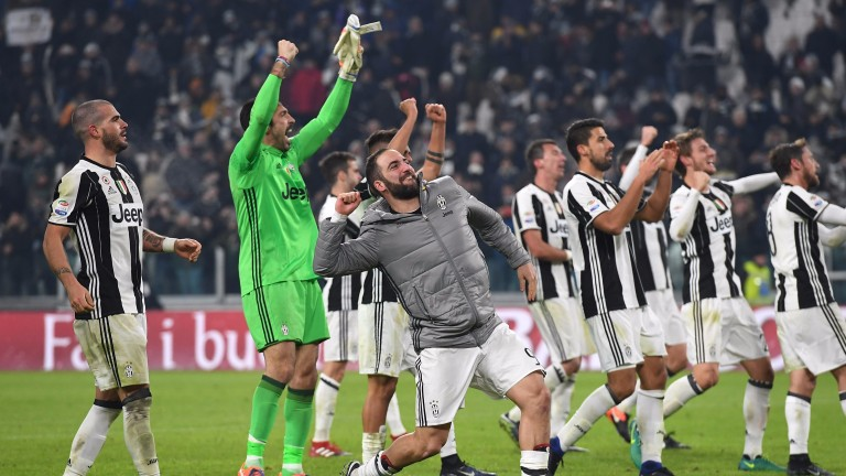 Juventus celebrate their 1-0 win over Roma in Turin
