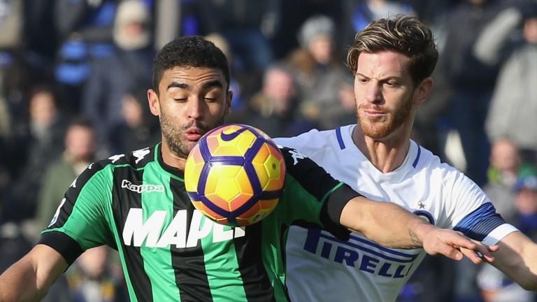 Sassuolo's Gregoire Defrel and Inter's Cristian Ansaldi
