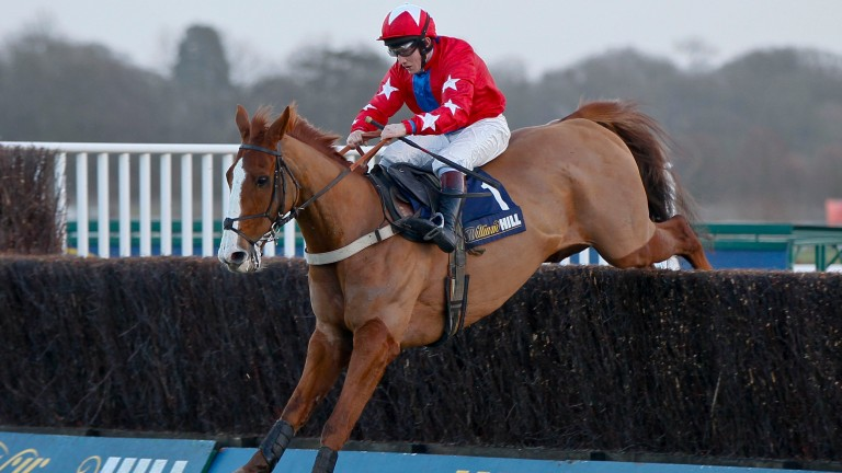 Sire De Grugy and Jamie Moore are clear in the 2013 Desert Orchid Chase