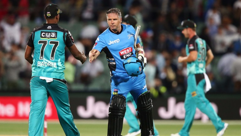 Brad Hodge of the Adelaide Strikers shakes hands with Samuel Badree of the Brisbane Heat after a Big Bash League match
