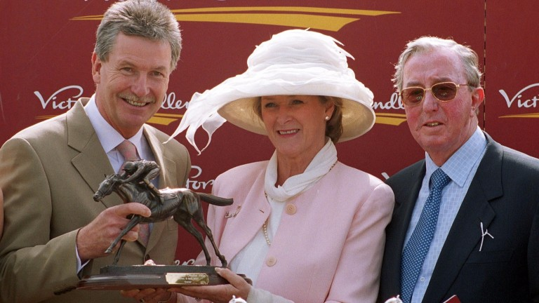 Jack Hanson (right) and Judith Boscombe receive the Chester Vase trophy from Victor Chandler's Neal Wilkins after the success of their Mr Combustible in 2001