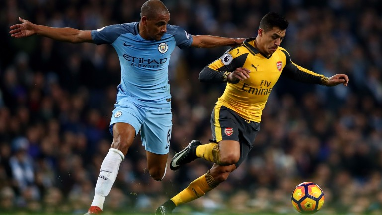 Arsenal's Alexis Sanchez gets away from his man