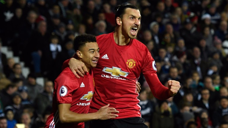 Zlatan Ibrahimovic and Jesse Lingard celebrate a goal