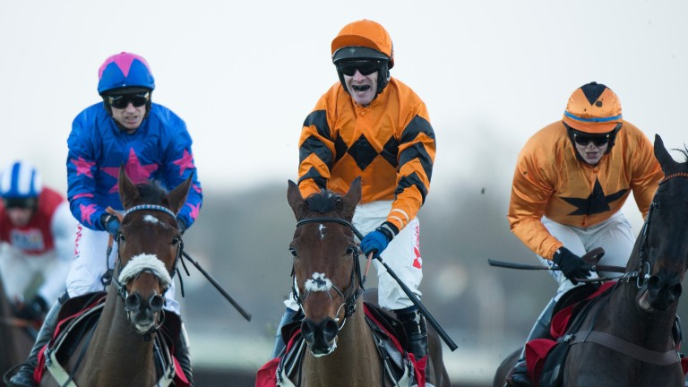 Thistlecrack (Tom Scudamore) wins the King George from Cue Card (Paddy Brennan,left)Kempton 26.12.16 Pic: Edward Whitaker