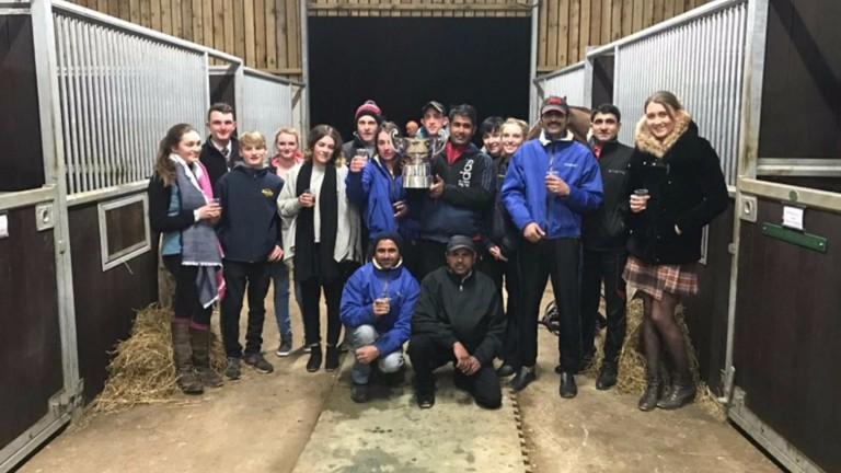 The Tizzard team celebrate with the 32Red King George VI Chase trophy on Boxing Day evening