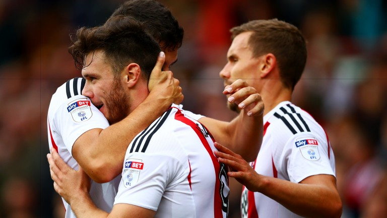 Scott Hogan is congratulated by his Brentford teammates