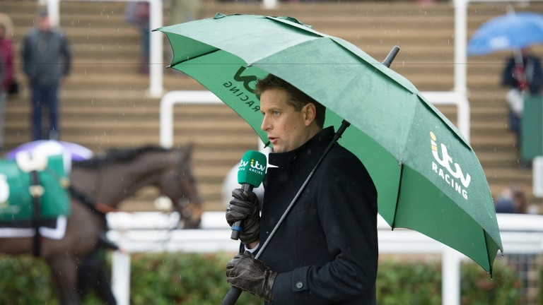 Ed Chamberlin presenting for ITV from a cold, wet and windy Cheltenham parade ring