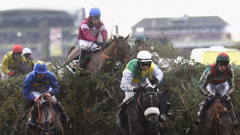 Rule The World (centre, jumping) on his way to victory in last year's Grand National
