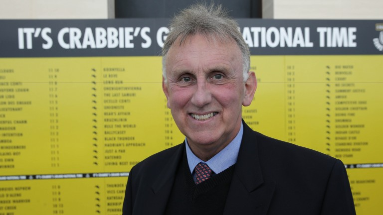 Handicapper Phil Smith in front of the traditional weights board at last year's launch