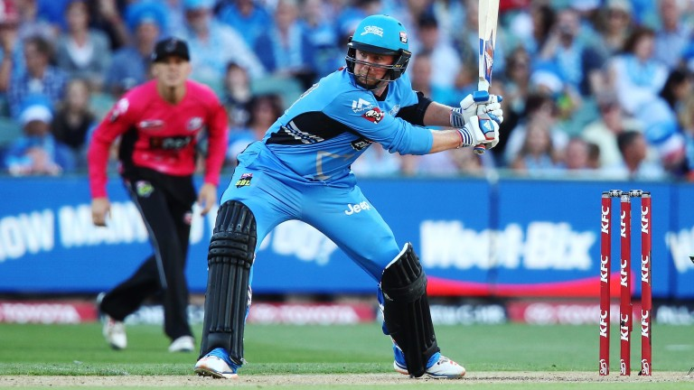 Ben Dunk of the Adelaide Strikers prepares to let fly against Sydney Sixers