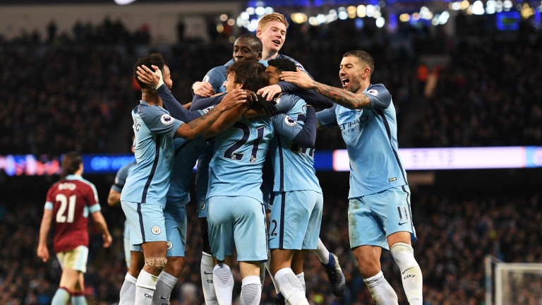 Manchester City's players celebrate Gael Clichy's goal against Burnley