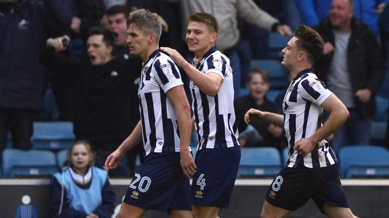 Millwall's Steve Morison (left) scored in the 3-0 win over a much-changed Bournemouth
