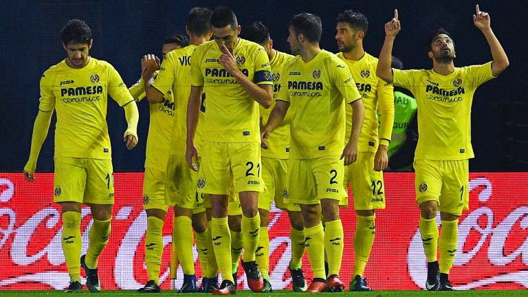 Villarreal celebrate their win over Atletico Madrid