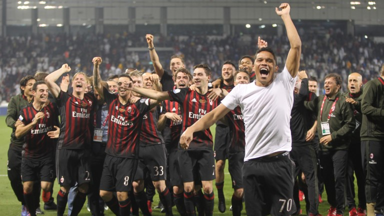 Carlos Bacca and his Milan mates celebrate their Supercoppa success