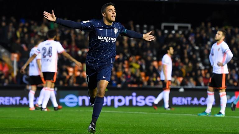 Malaga's Pablo Fornals celebrates a goal against Valencia