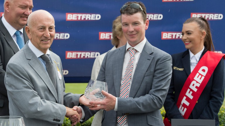 Fred Done (left), pictured presenting trainer David Griffiths with his prize after Take Cover's victory in the 2014 King George Stakes at Goodwood, stressed the importance of bookmaker sponsorship to racing
